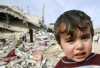 crying child outside bombed ruins